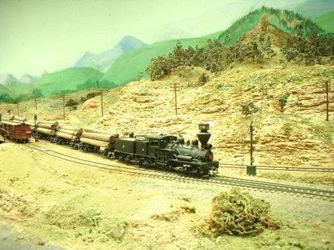 New lumber heading for Bobston. This class 'C' shay has pulled the train clear of the switch-back and is now pulling into town.