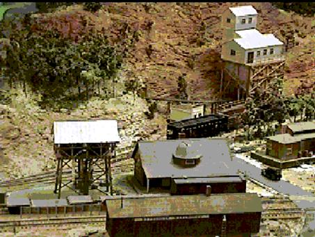 Water tower at Bettinger with run-around track.  The station was made by Revell around 1957 and the warehouse to the right was from Revell at a much more recent date