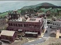 The factory at Boxton is a kitbash starting with (4) Revell Bakery kits.  Many of the structures in the background are kitbashed Design Preservation kits.  These are cut in two so that they serve as two separate structures.